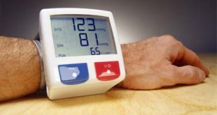 Blood Pressure Instrument on Man's Arm